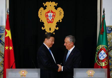 China's President Xi Jinping and Portuguese President Marcelo Rebelo de Sousa shake hands during a news conference in Lisbon, Portugal, December 4, 2018. REUTERS/Pedro Nunes