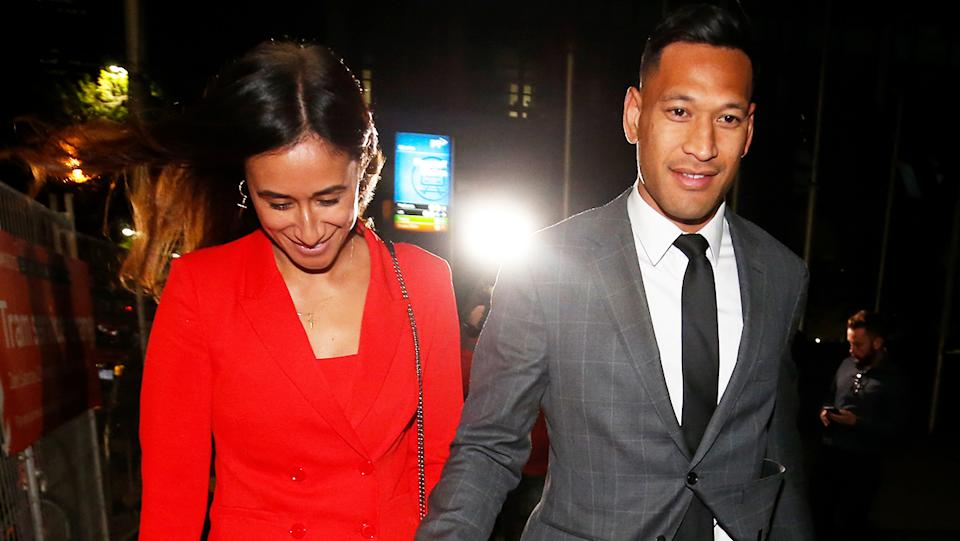 Maria Folau holds hands with husband Israel Folau as he leaves Federal Court on December 02, 2019.