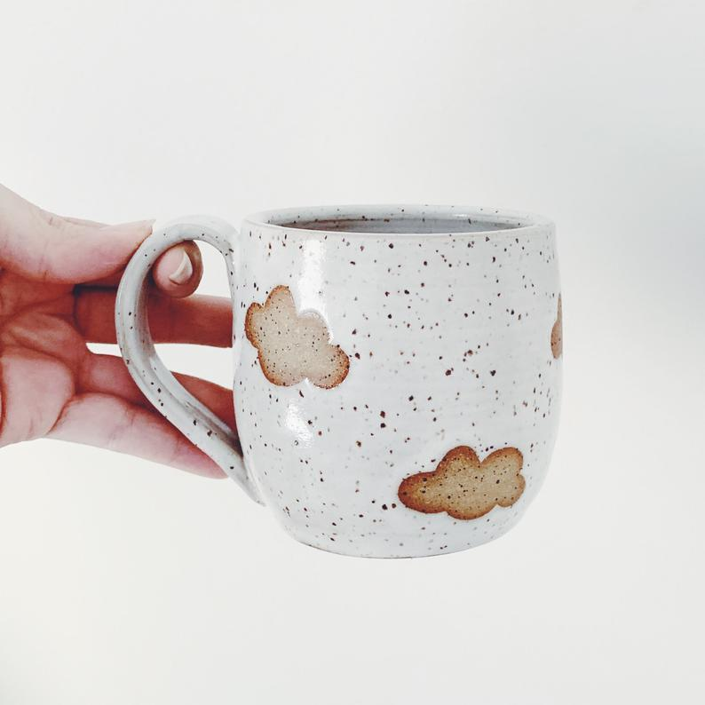 "<h3>The Lulu Bird Floating Clouds Ceramic Mug</h3> <br><strong>Best For: The</strong> <strong>PhD Grad<br>Budget: Under<br></strong> <strong>$50</strong><br>Let this handmade ceramic cloud mug serve as a dreamy congratulatory addition to your grad's cerebral coffee-vessel collection. <br><br><em>Shop <strong><a href=""https://www.etsy.com/shop/TheLuluBird?ref=simple-shop-header-name&listing_id=692747967"" rel=""nofollow noopener"" target=""_blank"" data-ylk=""slk:The Lulu Bird"" class=""link rapid-noclick-resp"">The Lulu Bird</a></strong></em><br><br><strong>TheLuluBird</strong> Floating Clouds Ceramic Mug, $, available at <a href=""https://go.skimresources.com/?id=30283X879131&url=https%3A%2F%2Fwww.etsy.com%2Flisting%2F692747967%2Ffloating-clouds-ceramic-mug-speckled"" rel=""nofollow noopener"" target=""_blank"" data-ylk=""slk:Etsy"" class=""link rapid-noclick-resp"">Etsy</a><br><br><br><br>"