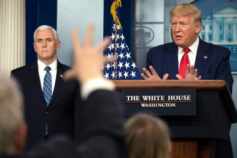US President Donald Trump speaks, flanked by US Vice President Mike Pence, announces recommendations on masks