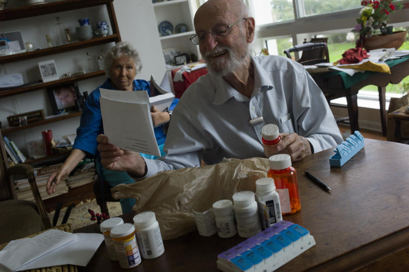 SARASOTA, FLORIDA - JANUARY 04: Charles Miller, 90, prepares the daily pills his wife will need for the week on January 4, 2020 in Sarasota, Florida. His wife has had a recent stroke and a heart attack, and needs approximately ten different medicines daily which need to be carefully monitored. (Photo by Andrew Lichtenstein/Corbis via Getty Images)