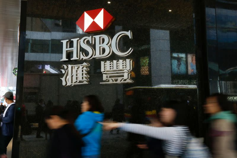 People walk past a major branch of HSBC at the financial Central district in Hong Kong