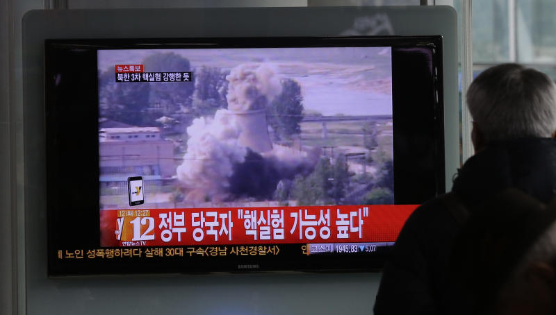 "CORRECTS THAT IMAGE ON SCREEN SHOWS DEMOLITION OF YONGBYON NUCLEAR COMPLEX - A South Korean man watches TV news showing file footage of the demolition of the cooling tower of the Yongbyon nuclear complex, following a report of a possible nuclear test conducted by North Korea, at the Seoul train station in Seoul, South Korea, Tuesday, Feb. 12, 2013. South Korea said it suspects a nuclear test caused an earthquake Tuesday in North Korea just north of a site where the country conducted two previous atomic tests. North Korea has yet to confirm whether the tremor resulted from a widely anticipated third nuclear test, though an analyst in Seoul said a nuclear detonation was a ""high possibility."" The Korean letters on TV read: ""Government official says possibility of a nuclear test is high."" (AP Photo/Lee Jin-man)"