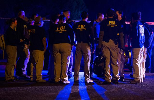 <p>FBI agents meet at the scene of an explosion in Austin, Texas, Sunday, March 18, 2018. At least a few people were injured in another explosion in Texas' capital late Sunday, after three package bombs detonated this month in other parts of the city, killing two people and injuring two others. (Photo: Nick Wagner/Austin American-Statesman via AP) </p>