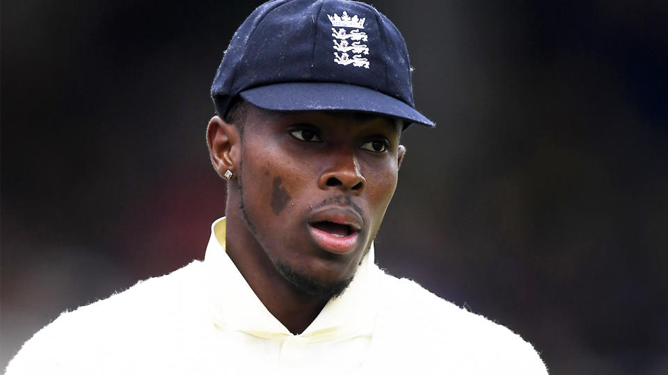 Jofra Archer looking on during a cricket match.