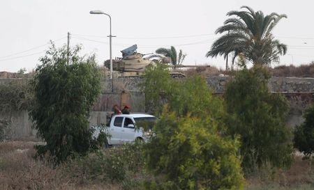 An Egyptian army tank is seen as members of Palestinian security forces loyal to Hamas patrol the border area of southern Gaza Strip with Egypt July 1, 2015 REUTERS/Ibraheem Abu Mustafa