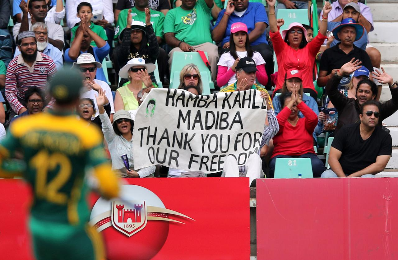 DURBAN, SOUTH AFRICA - DECEMBER 08: Fans pay tribute to Nelson Mandela during the 2nd Momentum ODI match between South Africa and India at Sahara Stadium Kingsmead on December 08, 2013 in Durban, South Africa. (Photo by Anesh Debiky/Gallo Images)