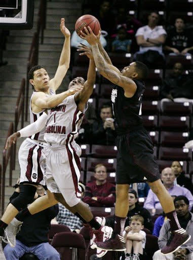 South Carolina's Brenton Williams (1) and Michael Carrera (24) battle fo the rebound with Mississippi State's Fred Thomas (1) during the first half of their NCAA college basketball game, Wednesday, March 6, 2013, in Columbia, S.C. (AP Photo/Mary Ann Chastain)