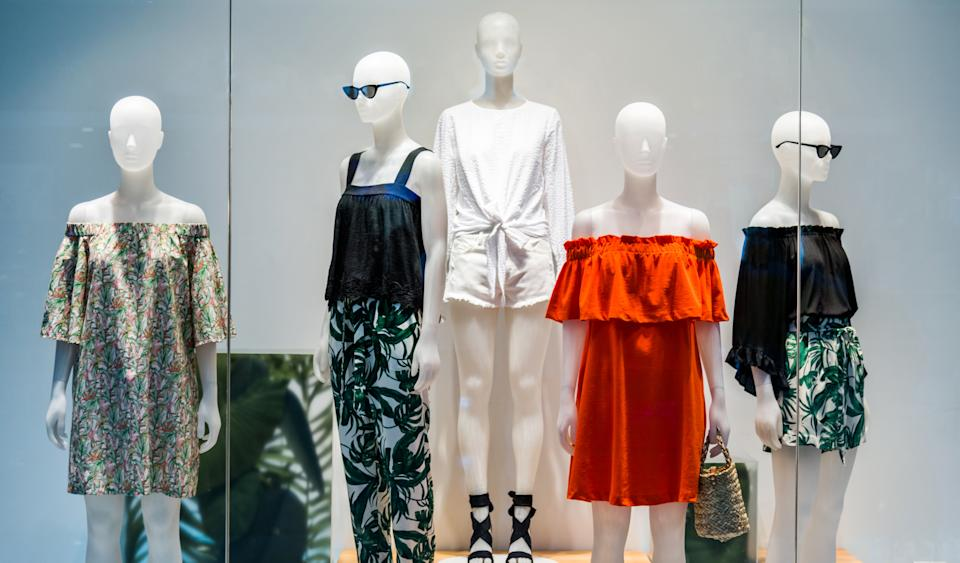 Woman mannequins in store window.