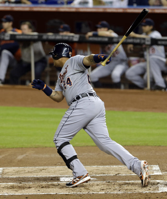 Detroit Tigers' Miguel Cabrera (24) follows through on a base hit against the Miami Marlins in the first inning of an interleague baseball game on Saturday, Sept. 28, 2013, in Miami. (AP Photo/Alan Diaz)