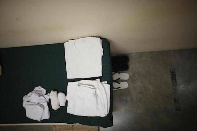GUANTANAMO BAY, CUBA - JUNE 25: (EDITORS NOTE: Image has been reviewed by the U.S. Military prior to transmission.) A prisoner's belongings are part of a static display setup for visitors in a prison cell at camp 6 where prisoners are housed in the communal facility at the U.S. military prison for 'enemy combatants' on June 25, 2013 in Guantanamo Bay, Cuba. President Barack Obama has recently spoken again about closing the prison which has been used to hold prisoners from the invasion of Afghanistan and the war on terror since early 2002. (Photo by Joe Raedle/Getty Images)