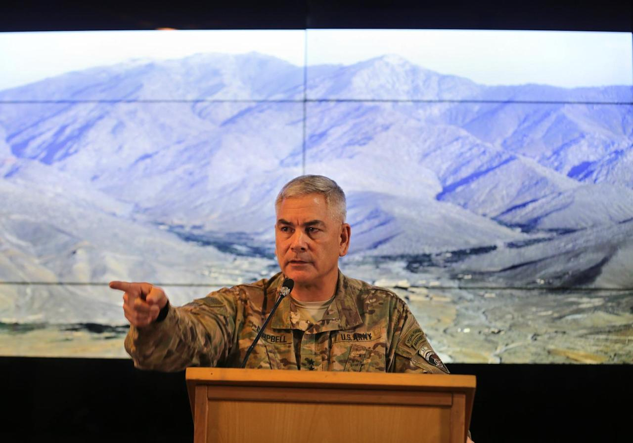 """U.S. Army General John F. Campbell, commander of U.S. and NATO forces in Afghanistan, speaks during a news conference at Resolute Support headquarters in Kabul, Afghanistan, Saturday, Feb. 13, 2016. Speaking weeks before he ends his command, Campbell confirmed that U.S. special forces would be deployed to Helmand to provide """"training, advice and assistance"""" to Afghan forces as they battle the Taliban. (Omar Sobhani/Pool Photo via AP)"""