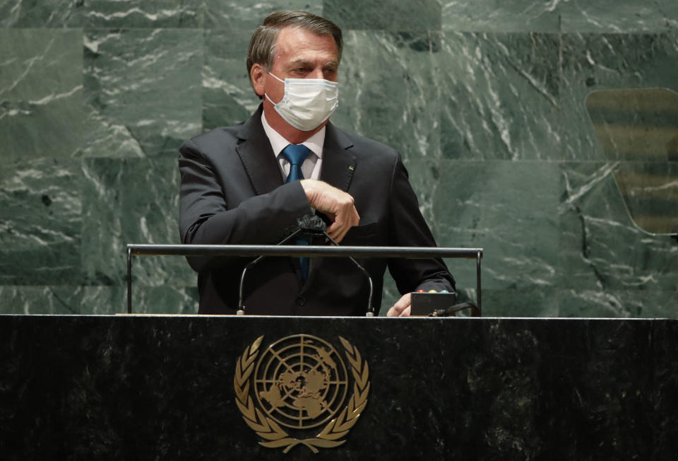 Brazil's President Jair Bolsonaro wears a protective face mask due to the coronavirus disease (COVID-19) pandemic as he arrives to addresses the 76th Session of the UN General Assembly on September 21, 2021 in New York. - The summit will feature the first speech to the world body by US President Joe Biden, who has described a rising and authoritarian China as the paramount challenge of the 21st century. (Photo by Eduardo MUNOZ ALVAREZ / POOL / AFP) (Photo by EDUARDO MUNOZ ALVAREZ/POOL/AFP via Getty Images)