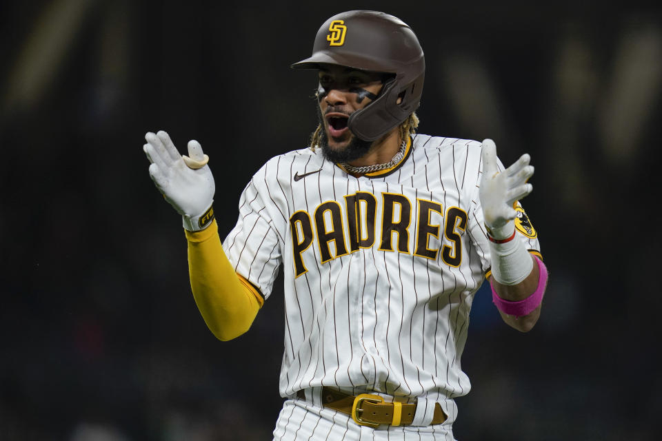 San Diego Padres' Fernando Tatis Jr. reacts after hitting a two-run home run during the third inning of a baseball game against the New York Mets, Thursday, June 3, 2021, in San Diego. (AP Photo/Gregory Bull)