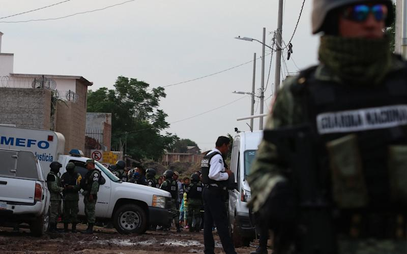 Members of the Mexican National Guard patrol the surroundings of a rehabilitation centre where an armed group killed at least 24 people, in Irapuato -  Str/EPA-EFE/Shutterstock/Shutterstock