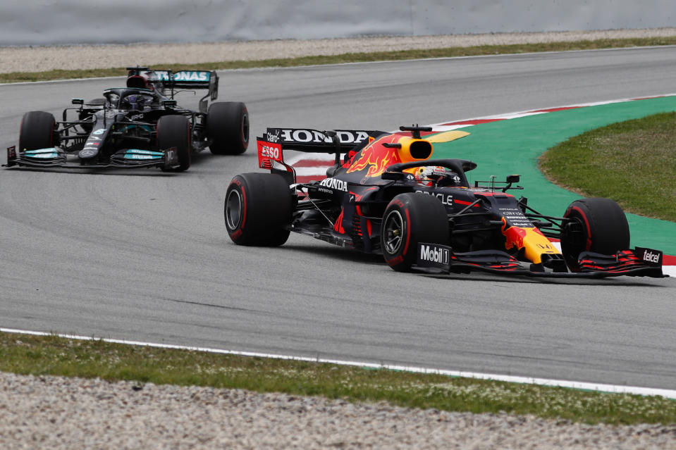 Red Bull driver Max Verstappen of the Netherlands takes a curve followed by Mercedes driver Lewis Hamilton of Britain during the Spanish Formula One Grand Prix at the Barcelona Catalunya racetrack in Montmelo, just outside Barcelona, Spain, Sunday, May 9, 2021. (AP Photo/Joan Monfort)