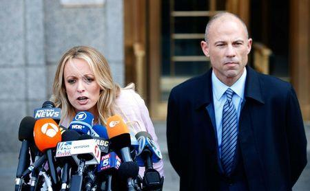 Adult film actress Stephanie Clifford also known as Stormy Daniels speaks to media along with lawyer Michael Avenatti outside federal court in Manhattan