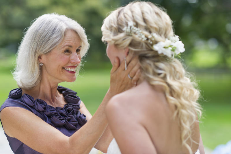 Mother of bride holds daughter's face on wedding day slams wedding dress as 'unflattering'