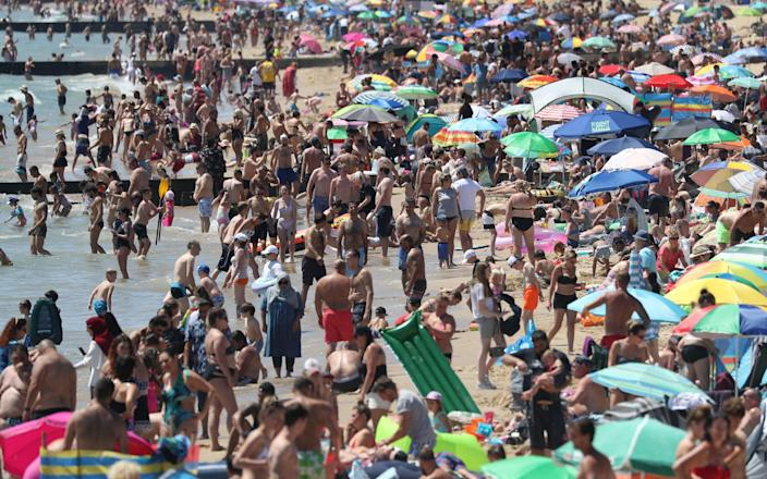 Crowds gathered on the beach in Bournemouth on Thursday, as temperatures soared. - PA