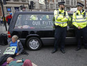 """A hearse carrying """"Our Future"""" in a coffin blocks Trafalger Square in central London Monday, Oct. 7, 2019. Extinction Rebellion movement blocked major roads in London, Berlin and Amsterdam on Monday at the beginning of what was billed as a wide-ranging series of protests demanding new climate policies. (AP Photo/Alastair Grant)"""