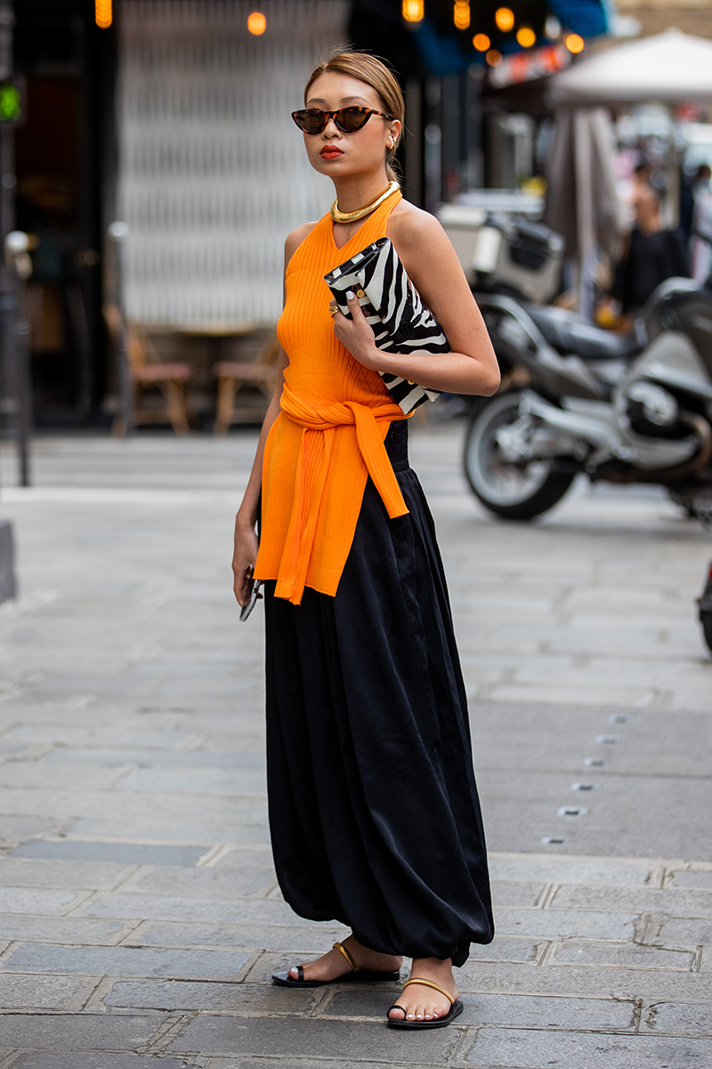 <p>A vibrant sleeveless knit is also an understated office staple, especially when teamed with balloon-shaped bottoms or a maxi skirt with flats.</p>