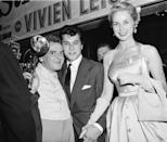 <p>American photographer Arthur Fellig (left) poses with Hollywood power couple Tony Curtis and Janet Leigh at a screening of <em>A Streetcar Named Desire</em>, circa 1951.</p>