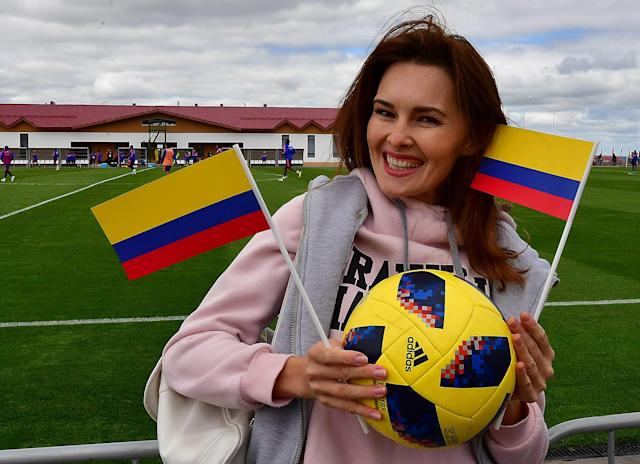 <p>A Colombia supporter cheers on her team during a training session in Kazan on June 14, 2018, ahead of the Russia 2018 World Cup football tournament. (Photo by LUIS ACOSTA / AFP) </p>