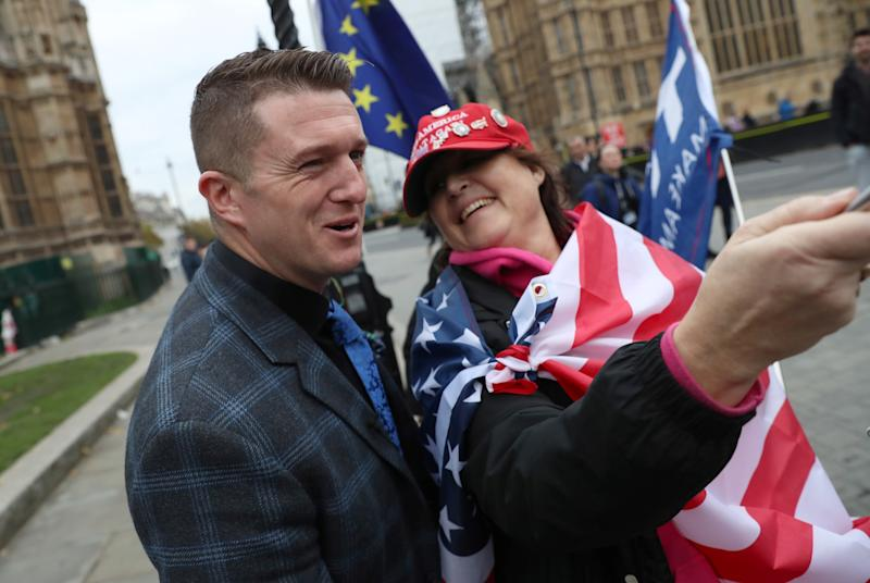 Far right activist Stephen Yaxley-Lennon, who goes by the name Tommy Robinson, poses for a selfie with a Donald Trump supporter, outside the Houses of Parliament in London, Britain, November 6, 2018. REUTERS/Simon Dawson