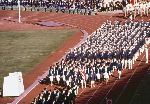 Pictured here is the US team entering the Tokyo Stadium at the opening ceremonies of the 1964 Summer Olympics in Tokyo, Japan, Oct. 10, 1964. (AP Photo)