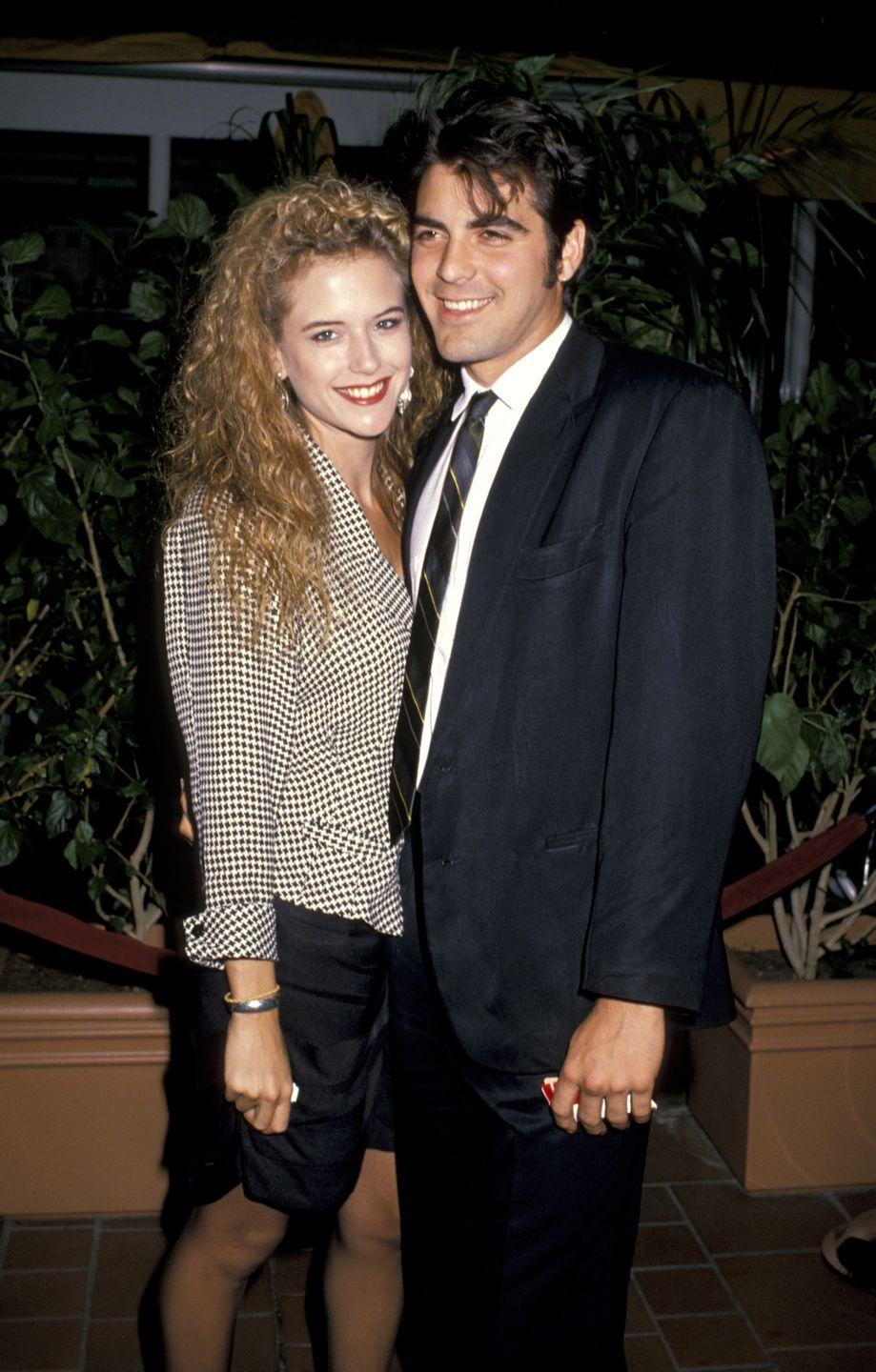 <p>George Clooney was still an up-and-coming actor (he hadn't landed his role on <em>ER </em>yet) when he attended the premiere of <em>Twins </em>with then-girlfriend Kelly Preston. </p>