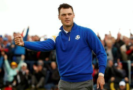 European Ryder Cup player Martin Kaymer celebrates his putt to halve the first hole during the 40th Ryder Cup singles matches at Gleneagles in Scotland September 28, 2014. REUTERS/Phil Noble