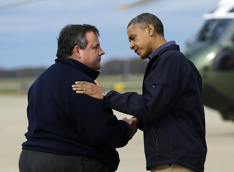 President Barack Obama is greeted by New Jersey Gov. Chris Christie upon his arrival at Atlantic City International Airport, Wednesday, Oct. 31, 2012, in Atlantic City, NJ. Obama traveled to the region to take an aerial tour of the Atlantic Coast in New Jersey in areas damaged by superstorm Sandy, (AP Photo/Pablo Martinez Monsivais)