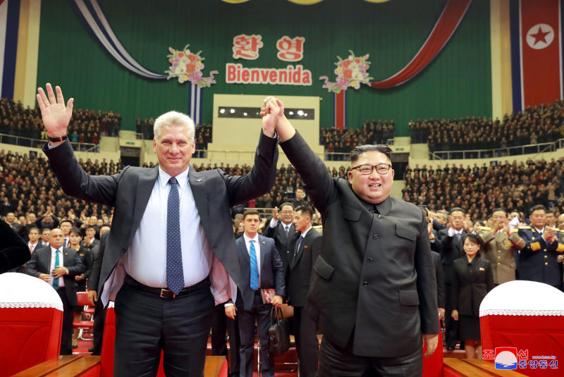 "In this Sunday, Nov. 4, 2018 photo released by the North Korean government, Cuban President Miguel Diaz-Canel, left, and North Korean leader Kim Jong Un raised joined hands during a welcome performance in Pyongyang, North Korea. Both, hoping to get out from under U.S. economic sanctions, agreed to expand and strengthen their strategic relations, North Korea's state media reported Monday, Nov. 5, 2018. Independent journalists were not given access to cover the event depicted in this image distributed by the North Korean government. The content of this image is as provided and cannot be independently verified. Korean language watermark on image as provided by source reads: ""KCNA"" which is the abbreviation for Korean Central News Agency. (Korean Central News Agency/Korea News Service via AP)"