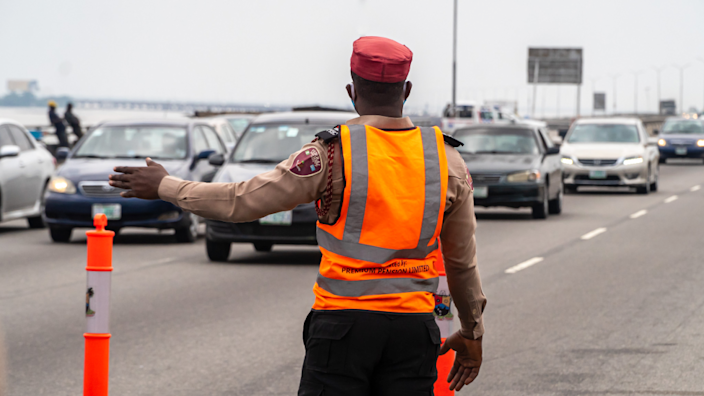Someone directing traffic on the Third Mainland Bridge, Lagos, Nigeria
