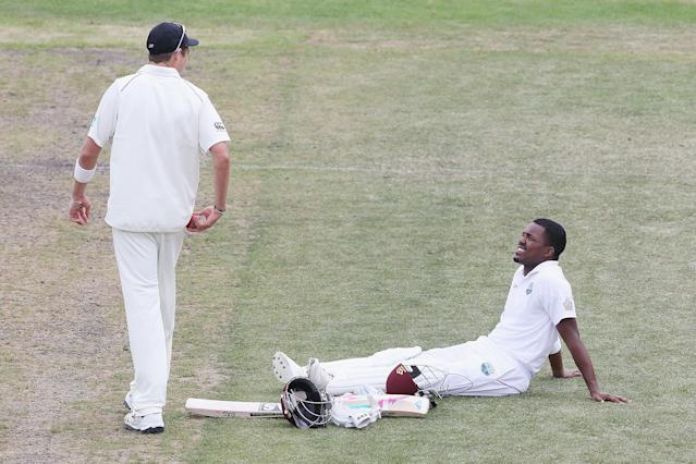 DUNEDIN, NEW ZEALAND - DECEMBER 06: Darren Bravo of the West Indies talks to Tim Southee of New Zealand during a drinks break during a drinks break during day four of the first test match between New Zealand and the West Indies at University Oval on December 6, 2013 in Dunedin, New Zealand. (Photo by Hannah Johnston/Getty Images)
