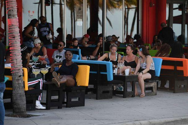 PHOTO: A general view as people are seen dining at local restaurants in Fort Lauderdale, Fla., June 24, 2020. (Larry Marano/REX via Shutterstock)