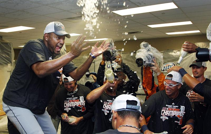 Detroit Tigers relief pitcher Jose Valverde, left, celebrates with teammates following a baseball game against the Kansas City Royals at Kauffman Stadium in Kansas City, Mo., Monday, Oct. 1, 2012. The Tigers defeated the Royals 6-3 and clinched the AL Central title. (AP Photo/Orlin Wagner)