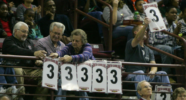South Carolina fans post the three points as Tiffany Mitchell scores during the first half of their NCAA college basketball game against Winthrop Friday, Dec. 20, 2013, in Columbia, SC. South Carolina defeated Winthrop 69-61.(AP Photo/Mary Ann Chastain)