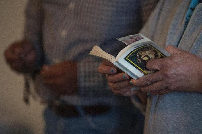 Within the strongly religious Latino community, many have meanwhile resorted to prayer in the hope that Trump will have a revelation and adopt a kinder view toward immigrants (AFP Photo/DAVID MCNEW)