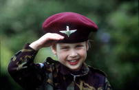 <p>Prince William in parachute regiment uniform in the gardens of his father's home Highgrove House saluting in 1986. (Tim Graham Photo Library via Getty Images)</p>