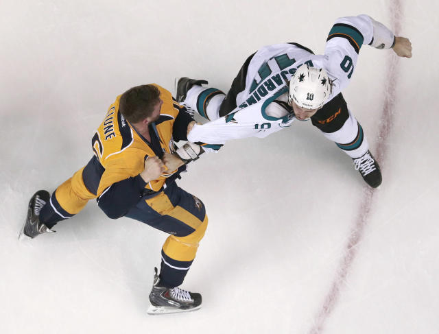 Nashville Predators forward Rich Clune (16) fights with San Jose Sharks center Andrew Desjardins (10) in the first period of an NHL hockey game on Saturday, Dec. 14, 2013, in Nashville, Tenn. (AP Photo/Mark Humphrey)