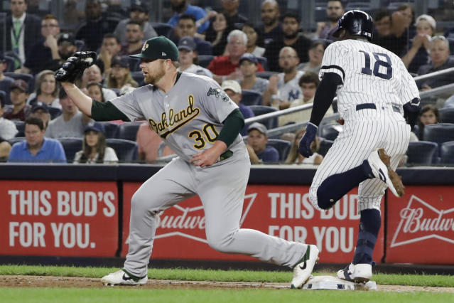 REMOVES REFERENCE TO SINGLE FOR GREGORIUS - New York Yankees' Didi Gregorius (18) beats the throw to first base as Oakland Athletics' Brett Anderson catches the ball, after Gleyber Torres was forced out at second during the third inning of a baseball game Friday, Aug. 30, 2019, in New York. (AP Photo/Frank Franklin II)