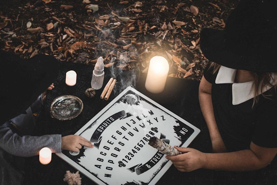 <p>Channel the spirits that surround us with this eerie ouija board backdrop. </p>