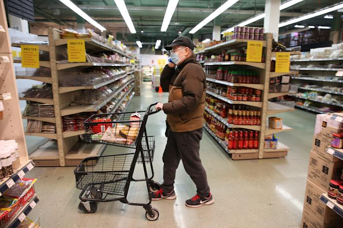 Check Chen shopped for groceries during special hours open to seniors only at Uwajimaya, an Asian specialty supermarket in Seattle in March 2020.