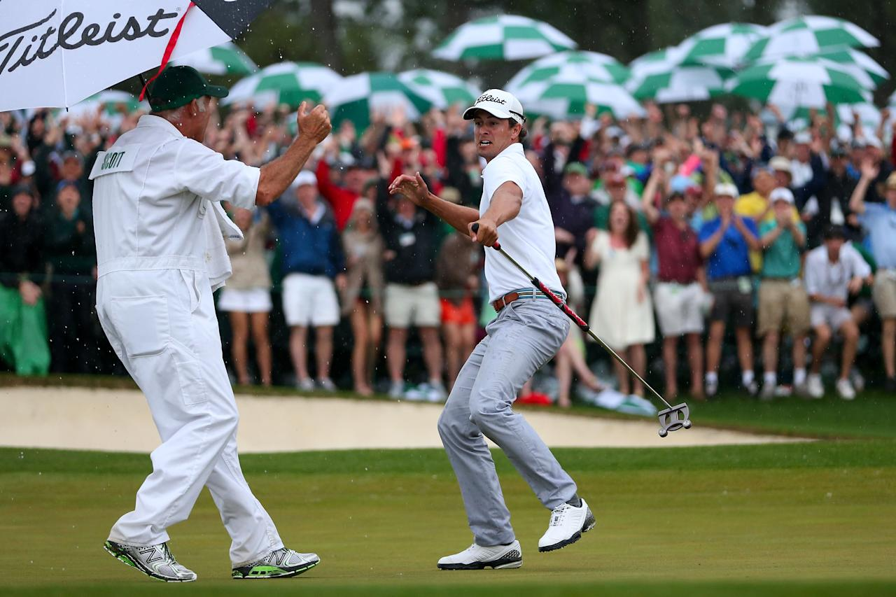AUGUSTA, GA - APRIL 14:  Adam Scott of Australia celebrates with caddie Steve Williams after making a birdie on the 18th hole during the final round of the 2013 Masters Tournament at Augusta National Golf Club on April 14, 2013 in Augusta, Georgia.  (Photo by Andrew Redington/Getty Images)