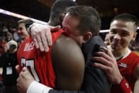Texas Tech head coach Chris Beard, center, gets a hug from center Norense Odiase, left, after an NCAA college basketball game against Iowa State, Saturday, March 9, 2019, in Ames, Iowa. Texas Tech won 80-73. (AP Photo/Charlie Neibergall)