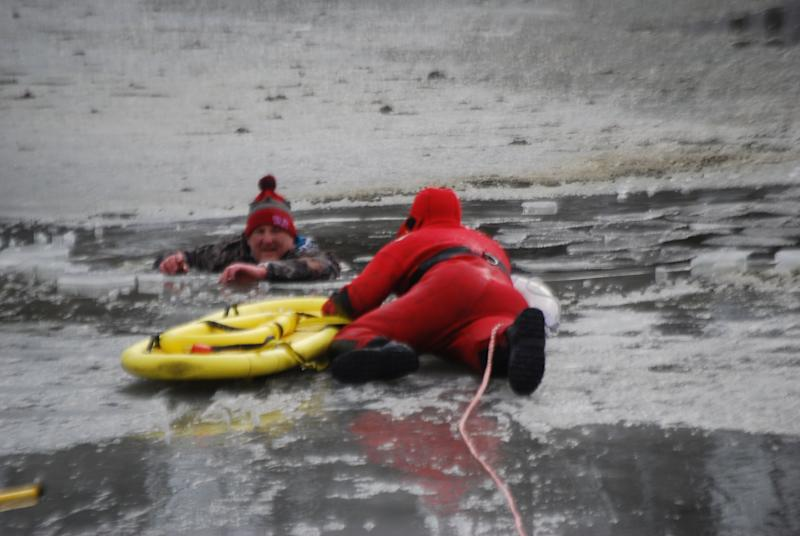 A man is rescued from Carousel Park pond on Friday.