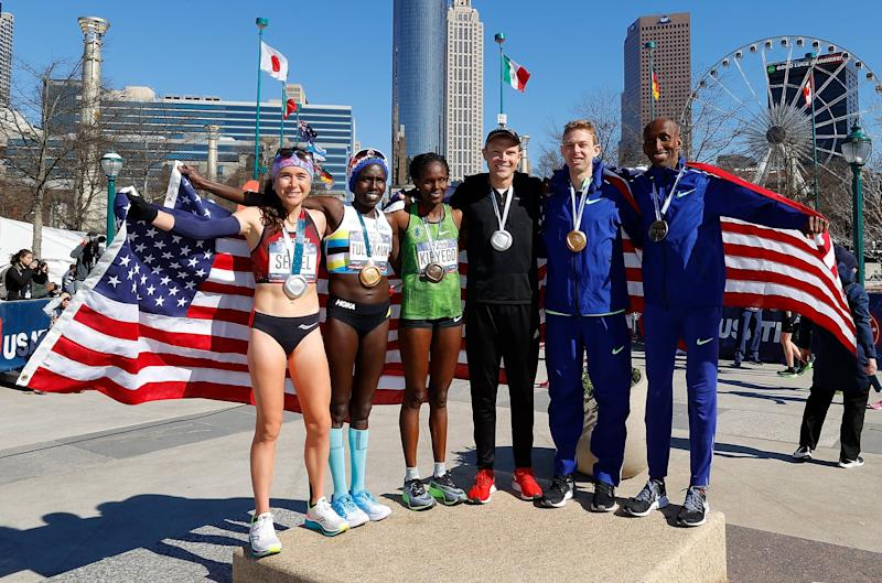 ATLANTA, GEORGIA - FEBRUARY 29: (L-R) Molly Seidel, Aliphine Tuliamuk, Sally Kipyego, Jacob Riley, Galen Rupp, and Abdi Abdirahman pose together after finishing in the top three of the Men's and Women's U.S. Olympic marathon team trials on February 29, 2020 in Atlanta, Georgia. (Photo by Kevin C. Cox/Getty Images)