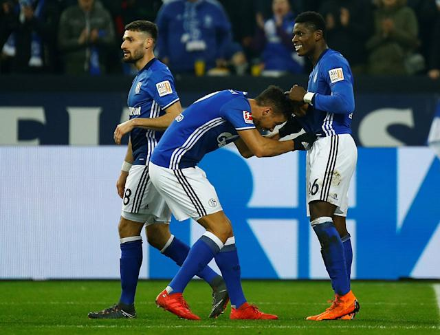 Soccer Football - Bundesliga - Schalke 04 vs TSG 1899 Hoffenheim - Veltins-Arena, Gelsenkirchen, Germany - February 17, 2018 Schalke's Breel Embolo celebrates with Franco Di Santo and Daniel Caligiuri after scoring their second goal REUTERS/Leon Kuegeler DFL RULES TO LIMIT THE ONLINE USAGE DURING MATCH TIME TO 15 PICTURES PER GAME. IMAGE SEQUENCES TO SIMULATE VIDEO IS NOT ALLOWED AT ANY TIME. FOR FURTHER QUERIES PLEASE CONTACT DFL DIRECTLY AT + 49 69 650050