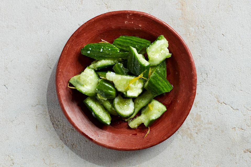 "If you have ever peeled, seeded, and sliced cucumbers for salads, this recipe offers yet one more option for preparing the crunchy summer veg (technically a fruit!). Smashing the cucumbers helps them to absorb seasonings. <a href=""https://www.epicurious.com/recipes/food/views/smashed-cucumber-salad-with-lemon-and-celery-salt?mbid=synd_yahoo_rss"" rel=""nofollow noopener"" target=""_blank"" data-ylk=""slk:See recipe."" class=""link rapid-noclick-resp"">See recipe.</a>"